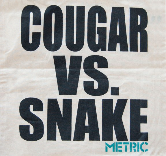 Cougar vs. Snake Tote Bag